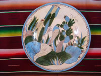 Mexican vintage pottery and ceramics, a wonderful pottery charger decorated with cacti and wonderful birds eating the tunas from a cactus, Tonala or Tlaquepaque, Jalisco, c. 1930's. Main photo of the Mexican pottery charger from Tlaquepaque or Tonala, Jalisco.