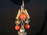 Mexican vintage jewelry, a beautiful pair of gold and coral earrings in a traditional colonial style, c. 1900. Another closeup photo of the bottom part of one earring.