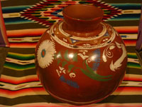 Mexican vintage pottery and ceramics, a lovely pottery jar or olla with wonderful decorations, including a whimsical rabbit, Michoacan, c. 1950's.  Photo of the second side of the jar.