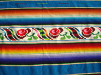 Mexican vintage textiles and Saltillo serapes, and Mexican vintage blouses and huipiles, a beautiful Saltillo serape (sarape) with a lovely turquoise background and a wonderful woolen and silk center medallion, c. 1930's. Closeup photo of the decorative sidebar, showing the lovely floral designes.