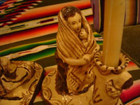 Mexican vintage pottery and ceramics, and Mexican vintage folk art, a pair of pottery candleholders, a man and a woman, Tzintzunzan, Michoacan, c. 1980.  Closeup photo of the woman with her baby.