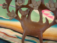 Mexican vintage folk art, and Mexican vintage pottery and ceramics, a lovely burnished tree-of-life (arbol de la vida) candlelabra with lovely decorations and a graceful deer at the base, by the famous folk artist Heron Martinez, Acatlan, Puebla, c. 1950's. Closeup photo of the deer at the front base.