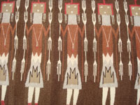 Native American Indian textiles, and Navajo vintage textiles and rugs, a beautiful Navajo textile depicting Navajo spiritual Yei figures, Arizona or New Mexico, c. 1940's. Closeup photo of part of the front showing the Yei figures of the Navajo Yei textile.