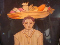 Mexican vintage straw-art, popote art or popotillo, a popote art pair of pictures depicting a man with a basket of fruit on his head and a lovely Mexican woman with her baby held in a rebozo around her shoulders, c. 1930's. Closeup photo of the man's face.
