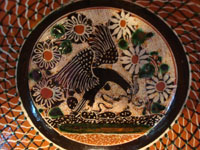 Mexican vintage pottery and ceramics, a beautiful pottery bowl with a petatillo background (cross-hatching, resembling a straw mat, or petate) and very fine artwork, signed Jose Bernabe, Tonala or San Pedro Tlaquepaque, c. 1950's. Closeup photo of the eagle at the center of the bowl.