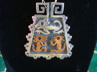 "Mexican vintage sterling silver jewelry, and Taxco vintage silver jewelry, a very lovely set of necklace and earrings made of ""married metals"", silver and copper, Taxco, c. 1940's.  Closeup photo of the pendant at the base of the Taxco silver jewelry necklace."