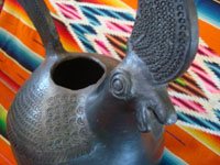 Mexican vintage folk art, and Mexican vintage pottery and ceramics, a wonderful Oaxacan blackware pottery sculpture of a rooster, Oaxaca, c. 1950's.  A closeup photo of the rooster's face.