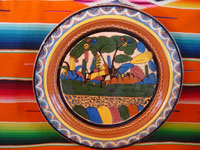 Mexican vintage pottery and ceramics, a beautiful petatillo charger with a central scene of a burro setting off for the mercado, loaded with merchandise, Tonala or San Pedro Tlaquepaque, c. 1930's.  Main photo of the petatillo charger.