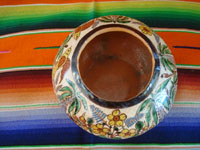 Mexican vintage pottery and ceramics, a very beautiful petatillo bowl with incredibly fine glazing and artwork, Tonala or San Pedro Tlaquepaque, c. 1930. Photo shot from above the bowl. looking down.