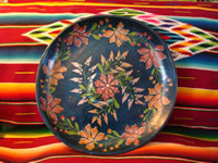 Mexican wood carving, Olinala laquerware charger, c. 1940.