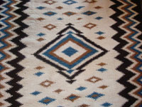 Mexican vintage sarapes and textiles, a rare Mayo weaving, c. 1930. Beautifully woven of wonderfully soft wool, and with vibrant colors of blue and brown. Photo of center diamond.