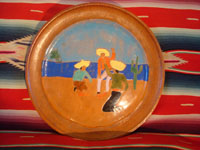 American vintage pottery, a San Jose plate from the San Jose Company in Texac, c. 1930. The plate is decorated with a scene of a Mexican cockfight, and is extremely well done.