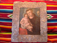 Mexican vintage devotional art and folk art, a wonderful retablo of St. Anthony and the Child Jesus painted on tin, in a wonderful reposse silver stamped frame, c. 1880's.  Main photo of retablo and silver frame.