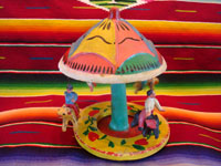 Mexican vintage pottery and ceramics, and Mexican vintage folk art, a wonderful merry-go-round with fantastic figures, attributed to Candelario Medrano, Santa Cruz de las Huertas, Jalisco, c. 1970's. Main photo of carousel.