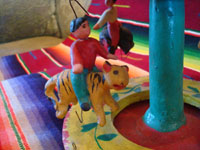 Mexican vintage pottery and ceramics, and Mexican vintage folk art, a wonderful merry-go-round with fantastic figures, attributed to Candelario Medrano, Santa Cruz de las Huertas, Jalisco, c. 1970's. Another closeup of a rider.