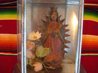 Mexican vintage devotional art and tin-work art, a very well-made tin-work and glass nicho with an image of Our Lady of Guadalupe made of pottery, c. 1950's. A closeup photo of the Virgin.