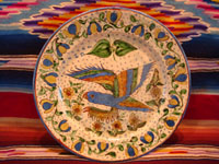 Mexican vintage pottery and ceramics, a very rare and beautiful plate with the wonderful starry night background and a graceful parrot, Tlaquepaque or Tonala, Jalisco, c. 1920's. Photo of the front of the Tonala or Tlaquepaque pottery plate.