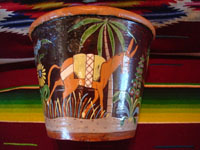 Mexican vintage pottery and ceramics, a pair of planters, very early and with exquisite artwork, Tlaquepaque or Tonala, Jalisco, c. 1920-30's. The scenes decorating these planters are incredible, with verdant plants, burros, birds, and animals, including graceful deer. A side view of one of the planters, showing a wonderful burro under a graceful palm tree.