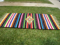 Mexican vintage textiles, and Mexican vintage Saltillo serapes (sarapes), a wonderful Saltillo serape with a black background and a very colorful center medallion of fine silk, c. 1930's. Main photo of the Saltillo serape.