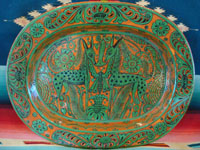 Mexican vintage pottery and ceramics, a very lovely fantasia (fantasia-ware) oval charger with very intricate and imaginative decorations, Tonala or Tlaquepaque, Jalisco, c. 1940. Main photo of the fantasia-ware oval charger.