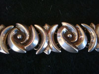 Mexican vintage silver jewelry, and Taxco vintage sterling silver jewelry, a wonderful sterling silver bracelet, with very good weight and an elegant design, Taxco, c. 1940's. Closeup photo of part of the Taxco silver bracelet.