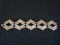 Mexican vintage silver jewelry, and Taxco vintage sterling silver jewelry, a beautiful and very graceful silver bracelet, with very fine repousse silverwork, Taxco, c. 1940's. Main photo of the Taxco silver bracelet.