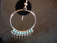Native American Indian silver jewelry, a beautiful pair of Zuni silver hoop earrings with wonderful turquoise and graceful silver dangles, Zuni, c. 1950's. Closeup photo of one of the Zuni silver earrings.
