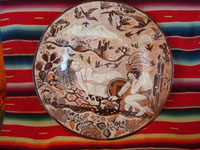 Mexican vintage pottery and ceramics, a fabulous pottery charger with incredible artwork, depicting the mythology of the origins of the volcanoes Popocatepetl (the man) and Iztlacihuatl (the woman), Tonala or Tlaquepaque, Jalisco, c. 1930-40's. Main photo of the front of the charger.