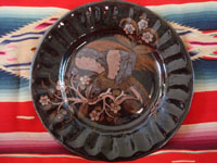 Mexican vintage pottery and ceramics, a beautiful pottery plate with a very wonderful background glazing and featuring a very beautiful eagle or exotic bird, Tonala or Tlaquepaque, Jalisco, c. 1930's. Main photo of the front of the Tlaquepaque pottery plate.