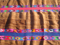 Vintage Mexican and Latin American textiles, a beautiful vicuna, woven of very fine and soft wool from native llamas, with colorful embroidery integrated into the design, Peru (or Andes region), c. 1950's. Another closeup photo of the front of the textile.