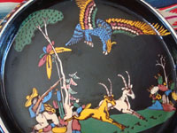 Mexican vintage pottery and ceramics, a wonderful pottery charger with beautiful and very detailed artwork set against a lovely black background glaze, Tonala or Tlaquepaque, Jalisco, c. 1930's.  Closeup photo of the hunting scene on the charger.
