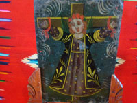 Mexican vintage devotional art, and Mexican vintage tinwork art, a lovely retablo painted on tin depicting Santa Liberata tied to a cross, Mexico, c. 1920. Closeup of the saint's face.