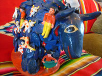 Mexican vintage folk art, and Mexican vintage pottery and ceramics, a wonderful folk-art blue, raging bull with matadors all over his back, attributed to the late Candelario Medrano, Santa Cruz de las Huertas, Jalisco, c. 1950's. Another side photo of the bull.