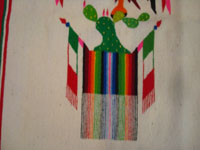 Mexican vintage textiles and Saltillo-style sarapes (serapes), a beautiful sarape with a lovely image of the Mexican flag, with the eagle and serpent, atop a beautiful cactus, c. 1930. Closeup photo of the cactus and Mexican flags at the feet of the eagle.