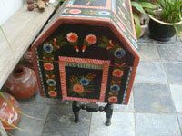 Mexican vintage folk art, and Mexican vintage woodcarvings and masks, a truly beautiful, large arcon, or trunk, of black laquered wood, with incredible artwork, Olinala, c. 1930's. A side-view of the arcon.