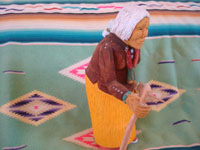 Native American Indian folk art and woodcarvings, a wonderful woodcarving of an old Navajo woman, signed by the great Navajo folk art woodcarver Johnson Antonio, Arizona or New Mexico, c. 1990. A side view of the woman.