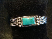 Native American Indian vintage sterling silver jewelry, and Navajo vintage silver jewelry, a beautiful Navajo sterling silver bracelet with a wonderful turquoise stone, Arizona or New Mexico, c. 1950's. Main photo of the Navajo silver bracelet.