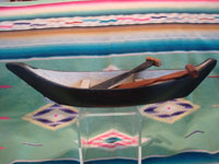 Native American Indian vintage folk art and woodcarving, a graceful and lovely model Nootka boat with oars, West Coast of Vancouver Island, British Columbia, c. 1960's. Main photo of the boat.
