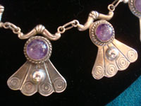 Mexican vintage sterling silver jewelry, and Taxco vintage sterling silver jewelry, a stunning sterling silver necklace with beautiful amethyst cabochons, Taxco, c. 1940's. Closeup photo of a part of the Taxco silver jewelry necklace.