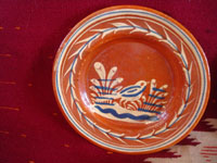 Mexican vintage pottery and ceramics, a very lovely set of three bandera-ware plates decorated with graceful birds, Tonala or San Pedro Tlaquepaque, c. 1940's. Closeup photo of the first plate.
