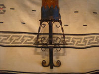 Mexican vintage folk art, and Mexican vintage tinwork and ironwork art, a lovely wrought iron wall sconce with a hand-blown amber glass shade, c. 1950's.  A photo showing the ironwork art near the base of the sconce.