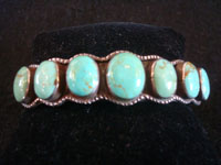 Native American Indian sterling silver jewelry, and Navajo silver and turquoise jewelry, a beautiful Navajo bracelet with an elegant design and wonderful turquoise stones, Arizona or New Mexico, c. 1950's. Main photo of the Navajo bracelet.