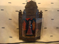 Mexican vintage devotional art, and Mexican vintage folk art, a lovely tinwork art and glass nicho with a wonderful carved wooden statue of Our Lady, the statue is c. 1930's. Frontal view of the nicho.