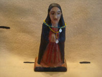 Mexican vintage devotional art, and Mexican vintage folk art, a lovely tinwork art and glass nicho with a wonderful carved wooden statue of Our Lady, the statue is c. 1930's. Photo of the statue of Our Lady.