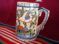 Mexican vintage pottery and ceramics, a beautiful pottery pitcher with fabulous artwork featuring graceful quetzales, birds, blue deer and ducks, surrounded by wonderful floral designs, Tonala or San Pedro Tlaquepaque, c. 1930's. Main photo of the pitcher.