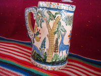 Mexican vintage pottery and ceramics, a beautiful pottery pitcher with fabulous artwork featuring graceful quetzales, birds, blue deer and ducks, surrounded by wonderful floral designs, Tonala or San Pedro Tlaquepaque, c. 1930's. A third side of the pitcher.