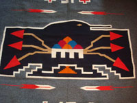 New Mexican vintage textile, a finely woven rug from the weaving center of Chimayo, New Mexico, c. 1930. This is from a very famous weaver, active from 1910-40, whose signature was the hummingbird in the center of this textile. Another closeup.