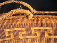 Native American Indian basket, a Northwest Coast twined purse, Tsimshian, c. 1900-10. Beautifully woven of cedar bark with geometric imbricated decoration and woven cedar bark handles. Closeup.
