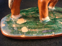 Mexican vintage pottery and ceramics, and Mexican vintage folk art, a pottery bull with fine hand-painted decoration, c. 1950. Signed on the bottom, Jose Trinidad Bernabe Lopez, Tonala, Jalisco Mexico. Photo of missing glaze on base.
