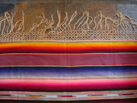 Mexican vintage textile, a wonderful Saltillo sarape, c. 1930. Very finely woven of wool with silk in the center diamond and decorative side-bars, and complete fringe. Closeup of one edge with fringe.